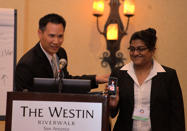 "Dr. Sam Wan ""passes the torch"" to new Conference Chair, Dr. Amee Patel."