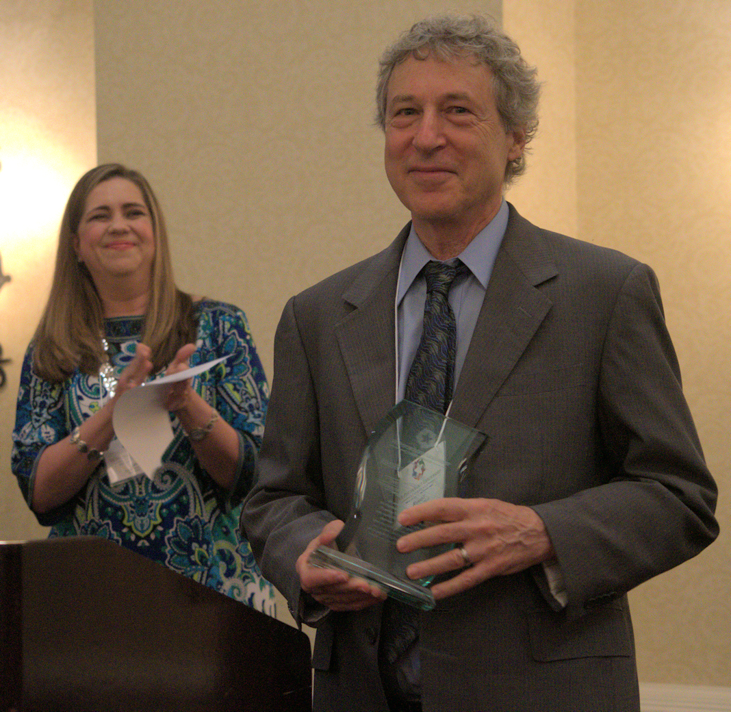 Russell Lemle receives leadership award with Lisa Kearney looking on.